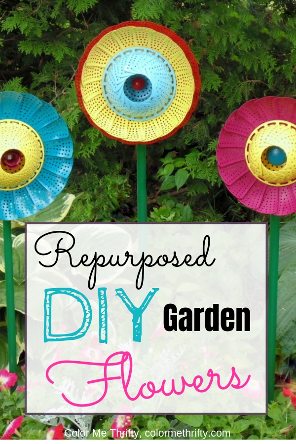 Create garden art flowers by repurposing folding steamer strainers