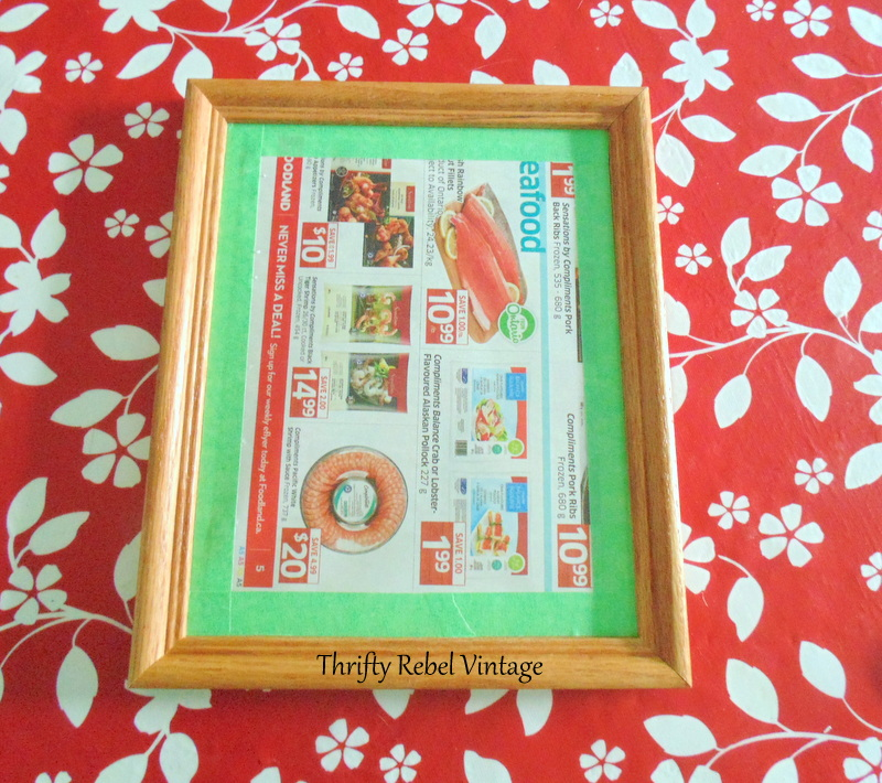 covering glass with paper and tape for how to spray paint picture frames