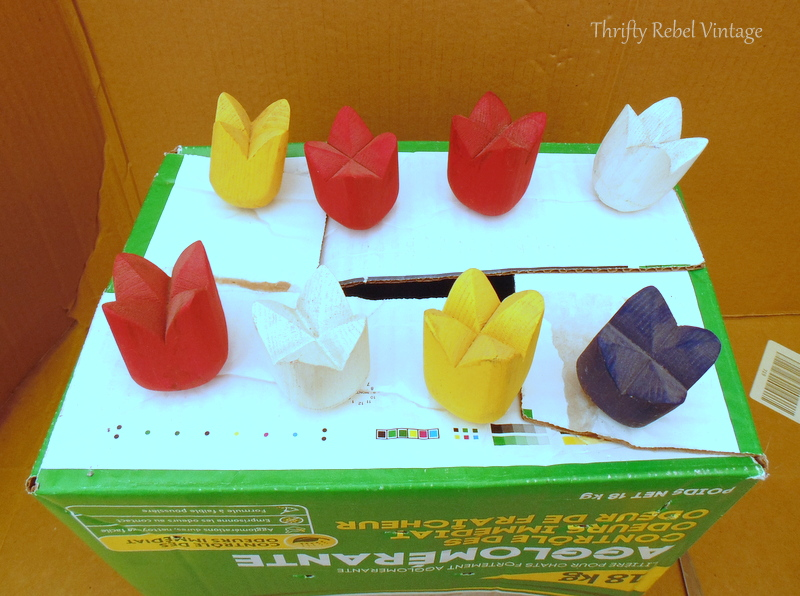 using cardboard box to spray paint wooden tulips