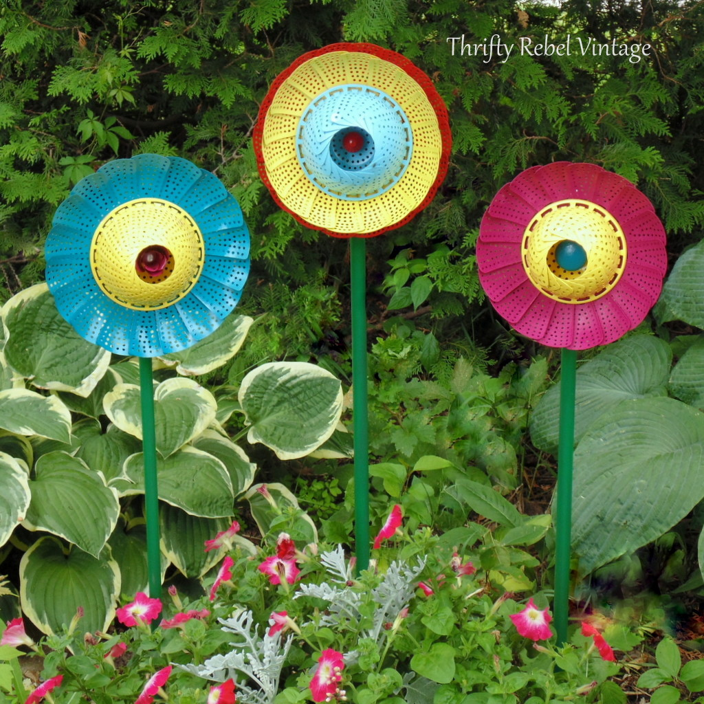 Repurposed folding steamers made into painted garden flowers