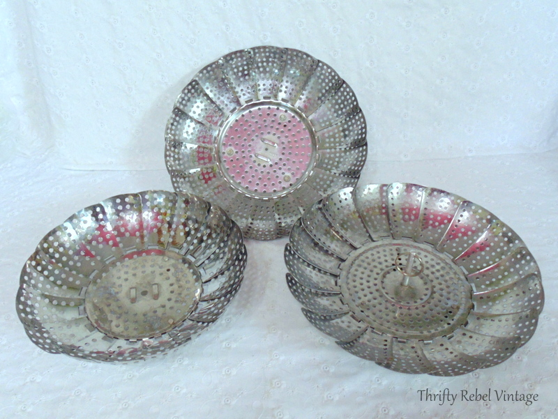 collection of metal strainers for making repurposed folding strainer flowers