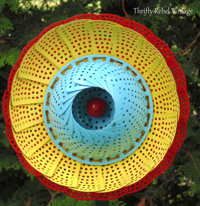 red yellow and blue repurposed folding strainer flowers