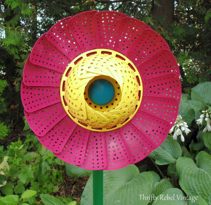 pink and yellow repurposed folding strainer flowers