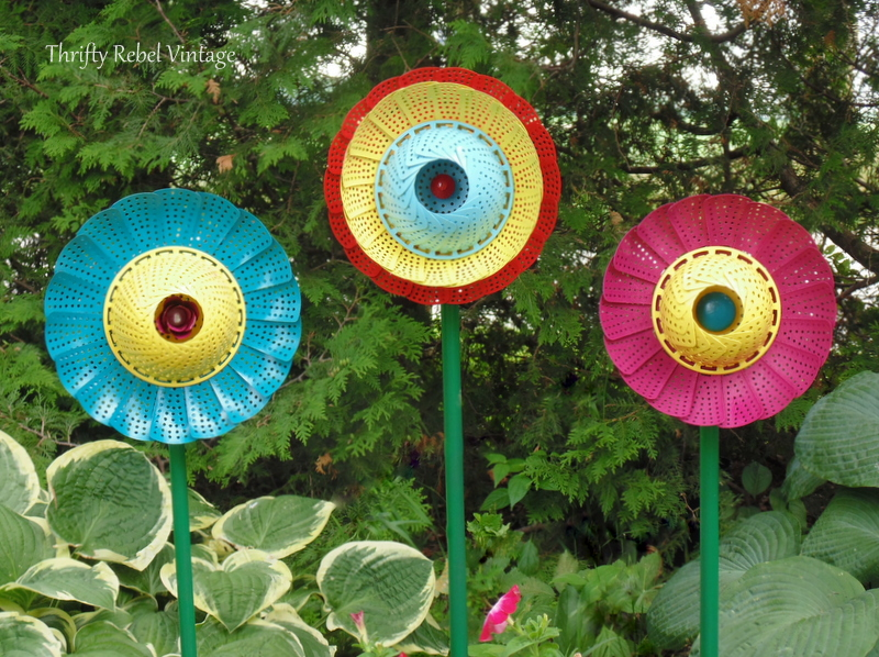 set of three colorful repurposed folding strainer garden art flowers