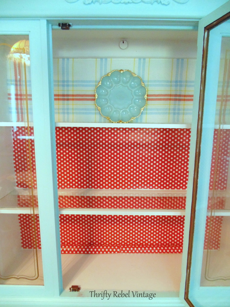 Repurposed tablecloth china cabinet makeover of a makeover