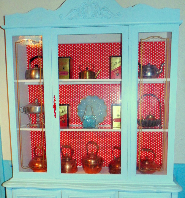 Repurposed wrapping paper china cabinet makeover