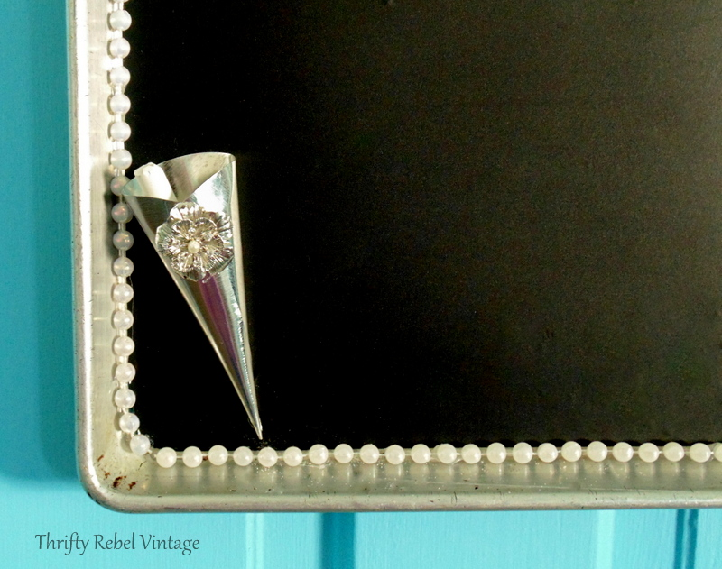 Repurposed baking cream horn cone as chalk holder for vintage cookie sheet chalkboard