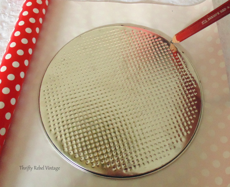 Using a cake pan insert for cutting round lid gift wrap piece for how to decoupage a garbage can