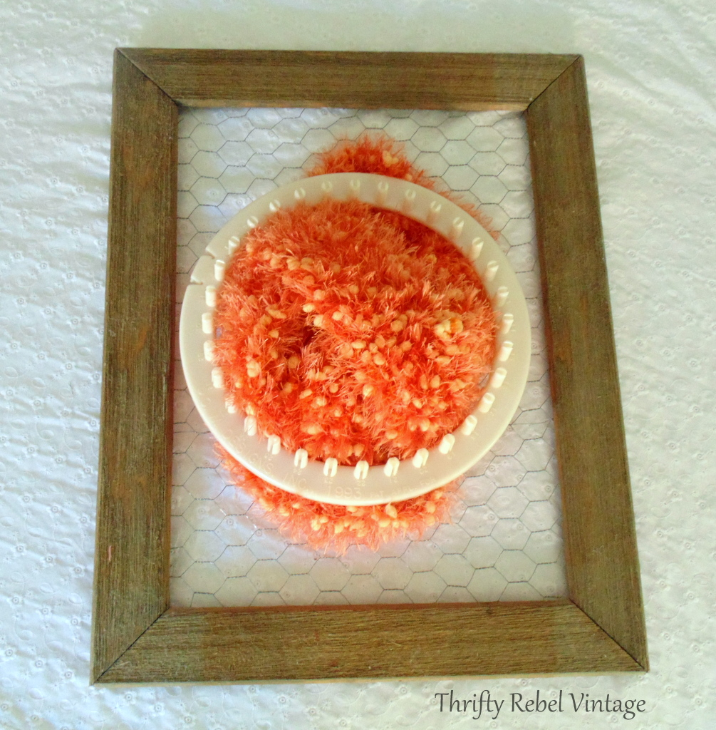 repurposed orange scarf and weaving frame for fall door wreath on rustic barnboard and chicken wire frame