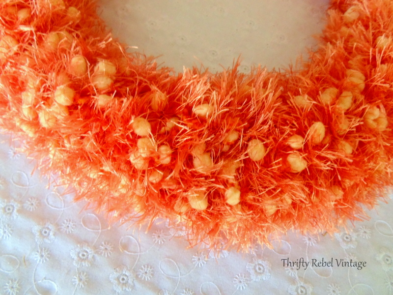 winding scarf around weaving frame for fall door decor