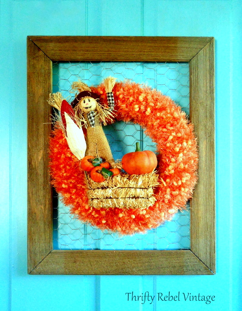repurposed orange scarf wreath attached to chicken wire rustic frame for fall door decor