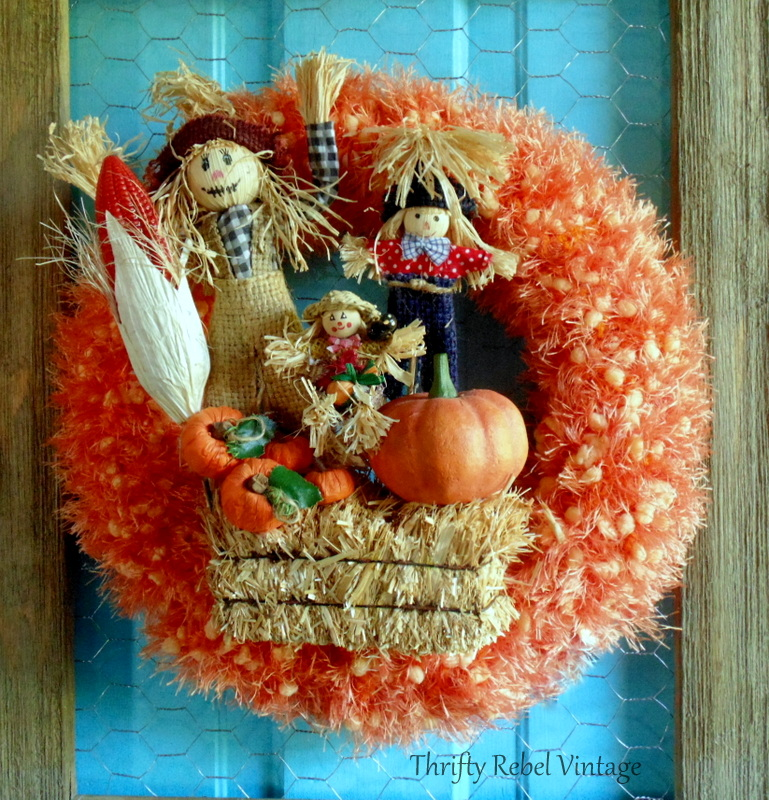 repurposed orange scarf scarecrow wreath attached to chicken wire rustic frame for fall door decor fall wreath