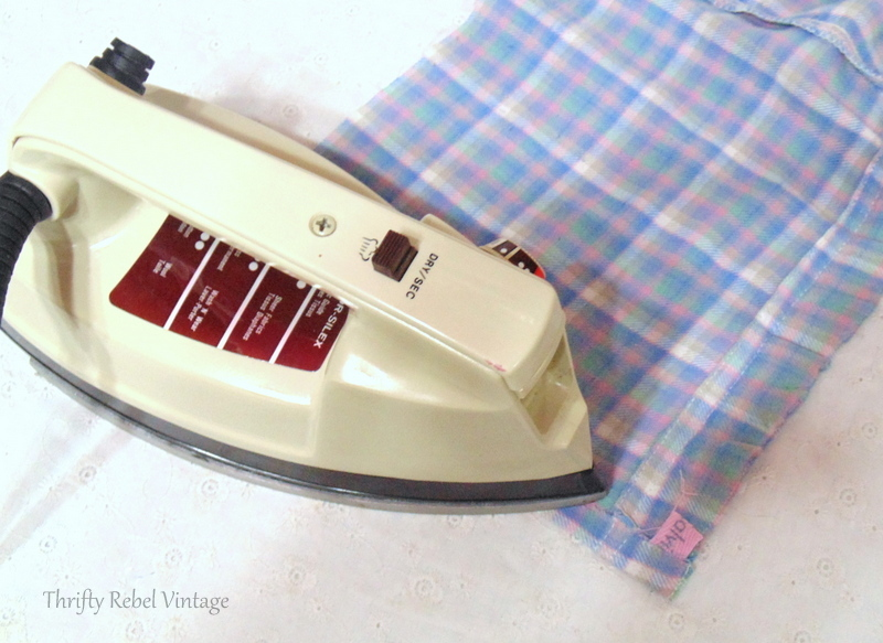 Hemming fabric by ironing on fabric adhesive for easy no sew window window valance made from flannel pants