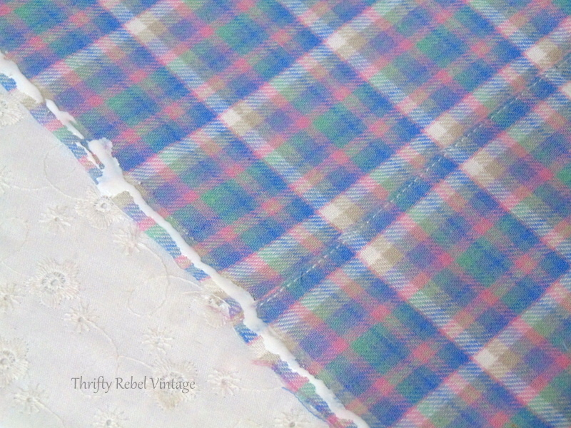 Using fabric glue to apply lace edging for easy no sew window valance made from flannel pants