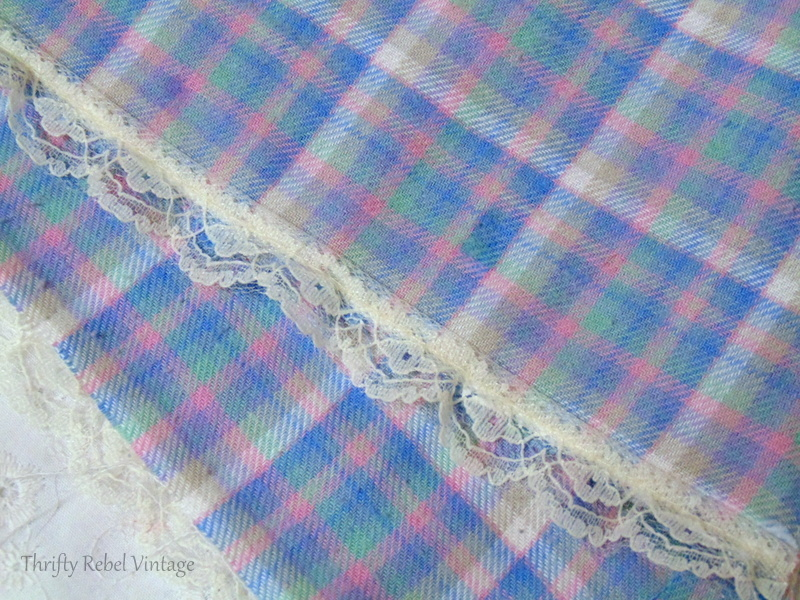 Lace edging applied with fabric glue for easy no sew window valance made from flannel pants