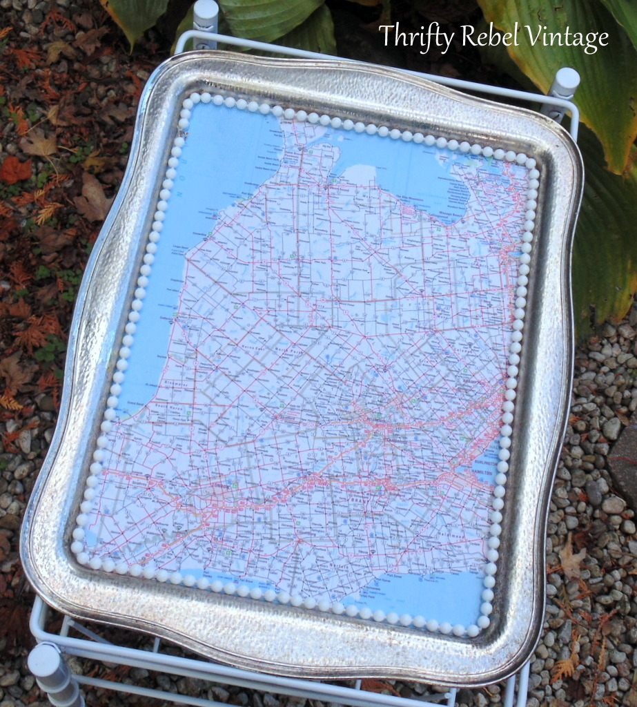 close up view of map top silver tray magazine table
