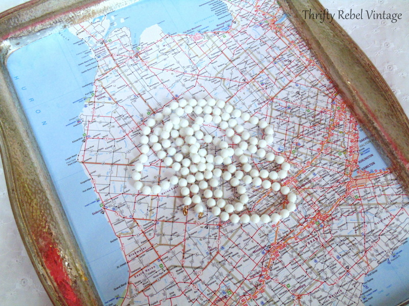 faux peral glass necklace for decoupaged silver tray map table