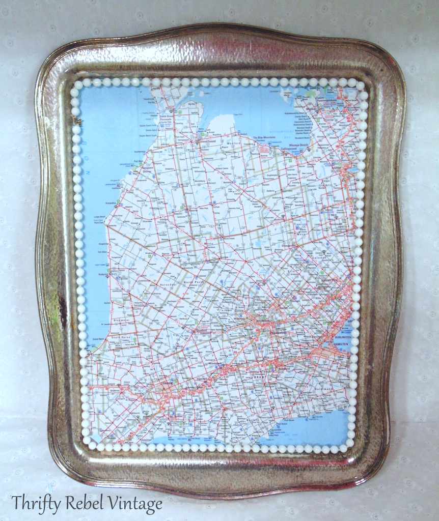 finished decoupaged silver tray for map table