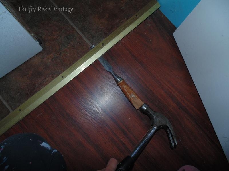 removing metal door threshholds for vinyl plank floating floor