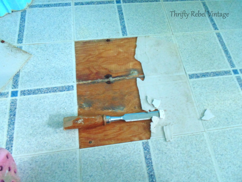 repairing vinyl tile floor by replacing a damaged tile