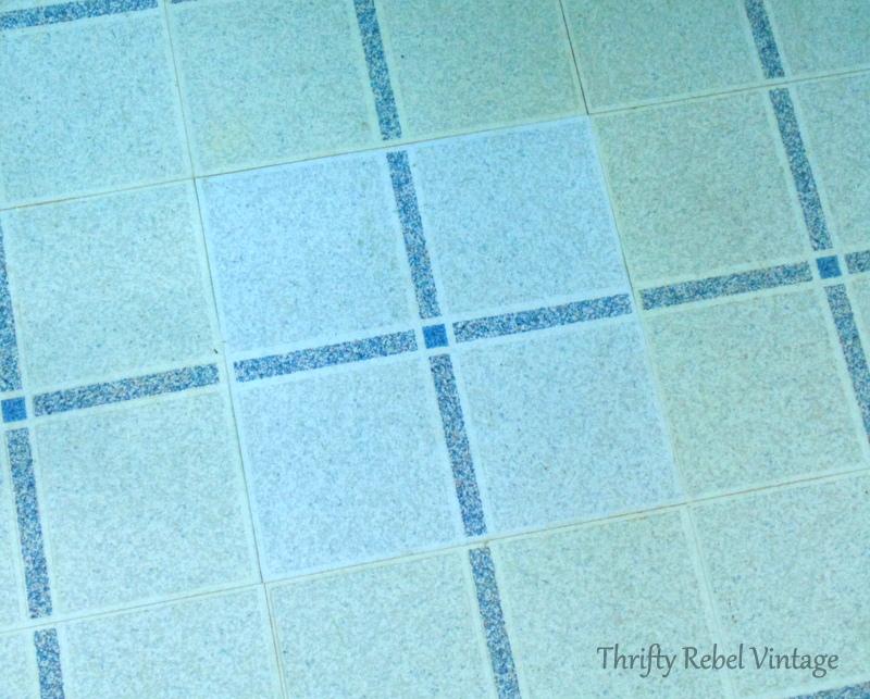 repairing vinyl tile floor by replacing a damaged tile