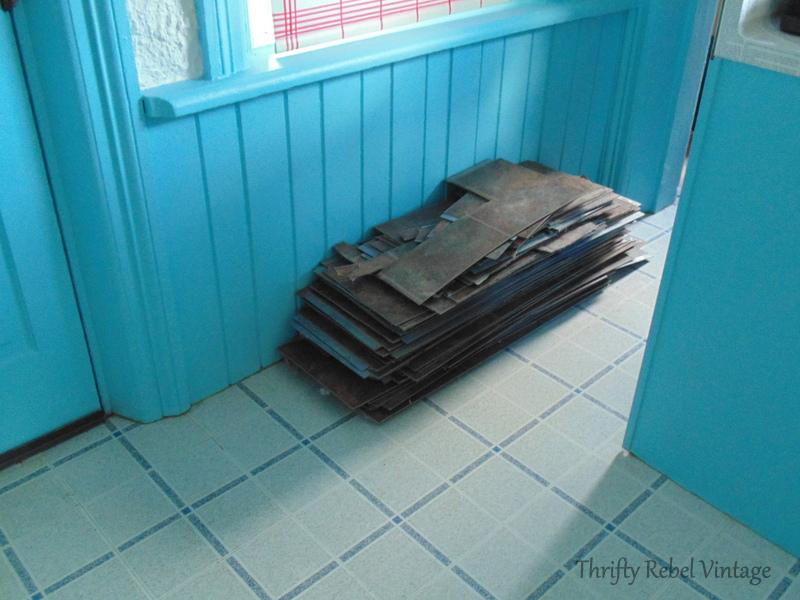 vinyl plank floating floor pile after removal