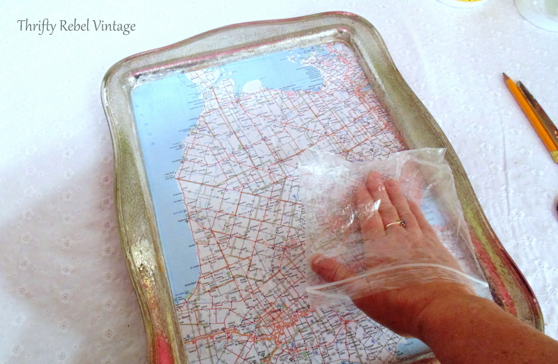 smoothing decoupaged map for decoupaged silver tray map table