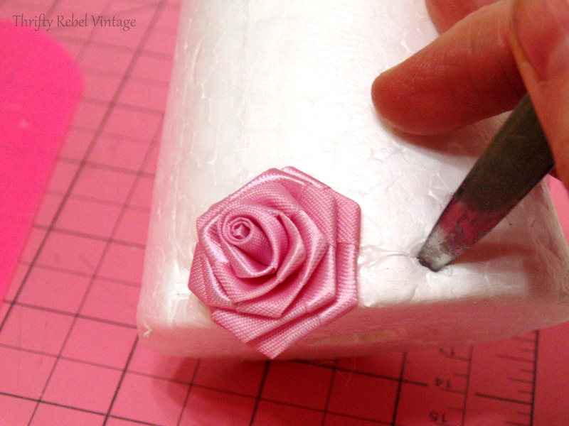 attaching miniature roses to styrofoam cone for miniatrue rose Christmas tree