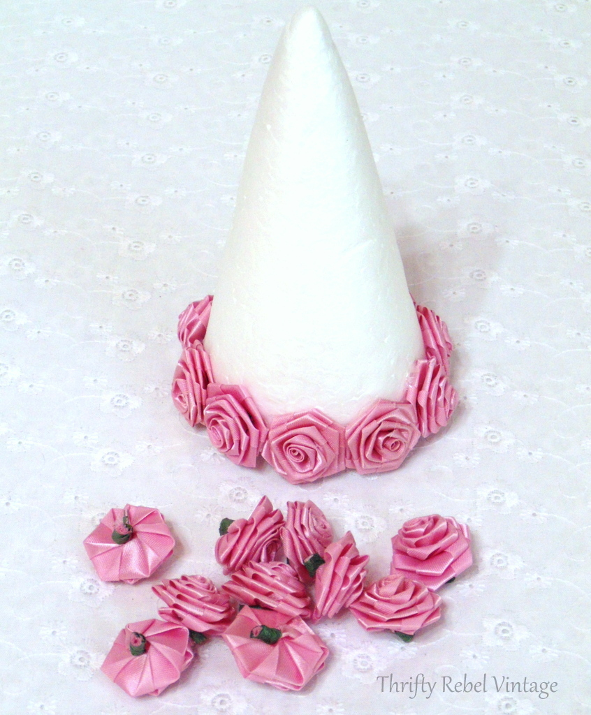 glued first row of miniature roses to styrofoam tree cone for miniature rose Christmas tree