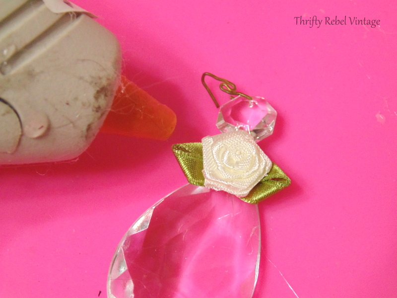 gluing flower at neck of chandelier crystal angel ornaments