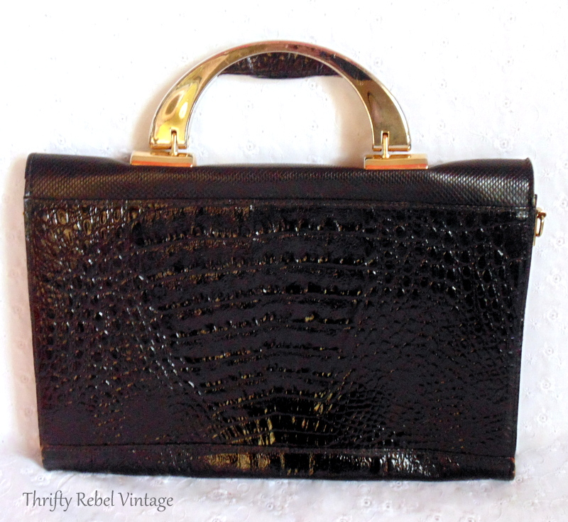back of black vinyl faux snakeskin purse clock