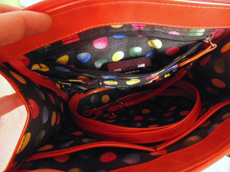 clockworks inside pocket in orange vinyl purse clock