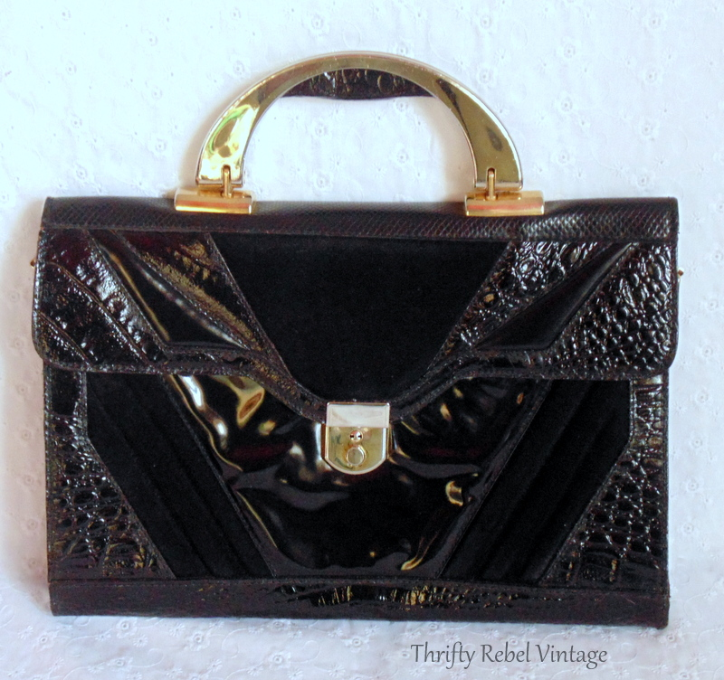 front of black vinyl faux snakeskin purse clock