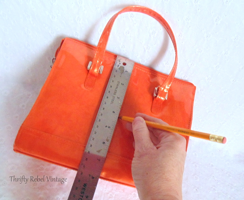 measuring the orange purse to fit the clockworks