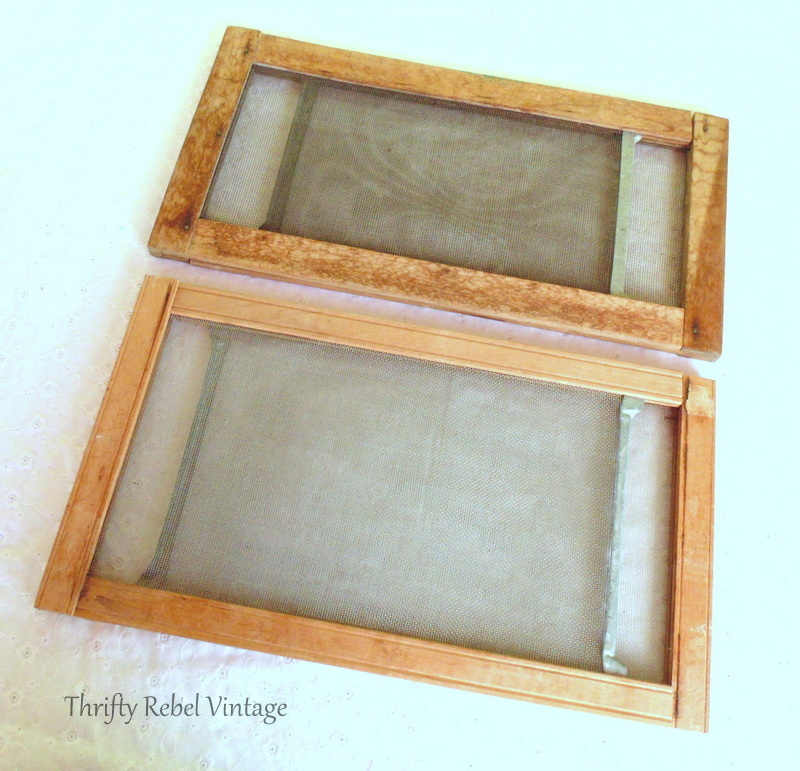 two vintage wooden window screen sliders closed