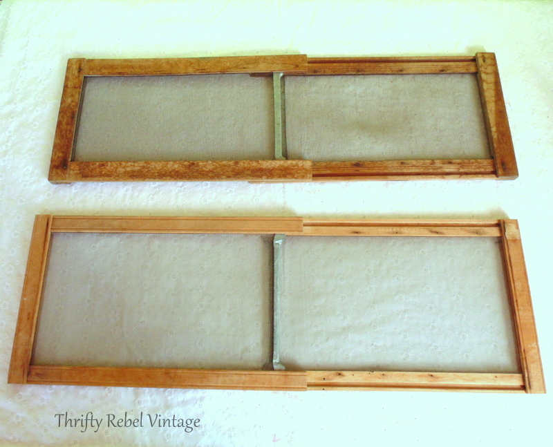two vintage wooden window screen sliders open
