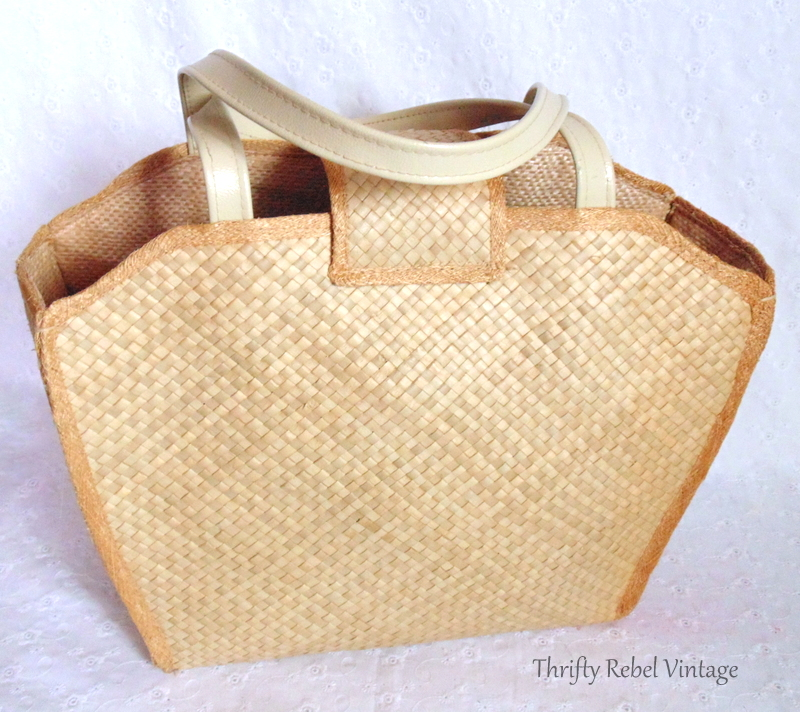 back of straw purse being repurposed as dresser organizer