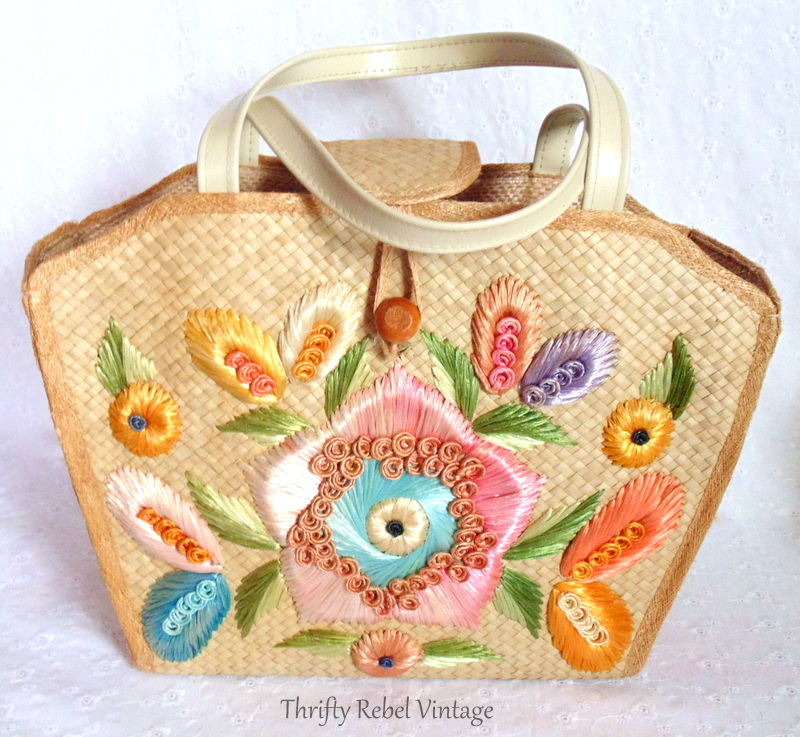 decorative flowers on front of straw purse being repurposed as dresser organizer 1