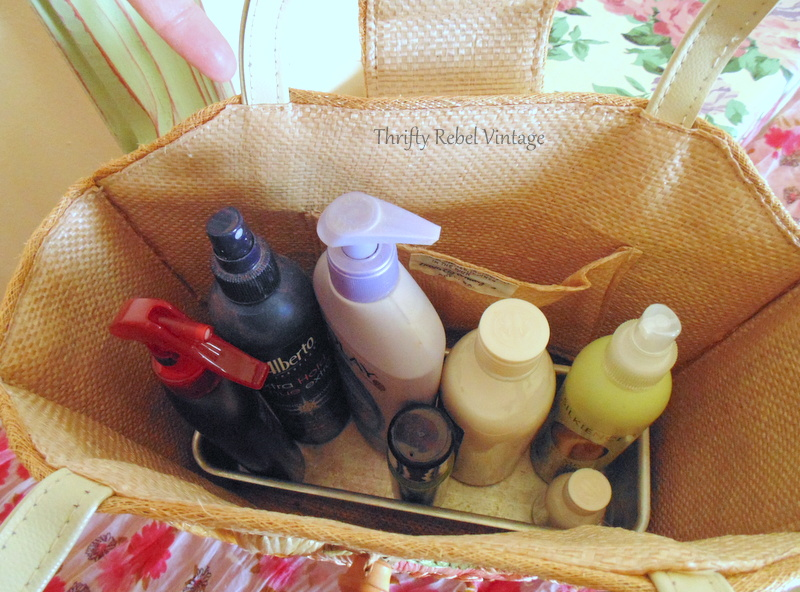 hair sprays lotions and other beauty products stored inside upcycled straw purse dresser organizer