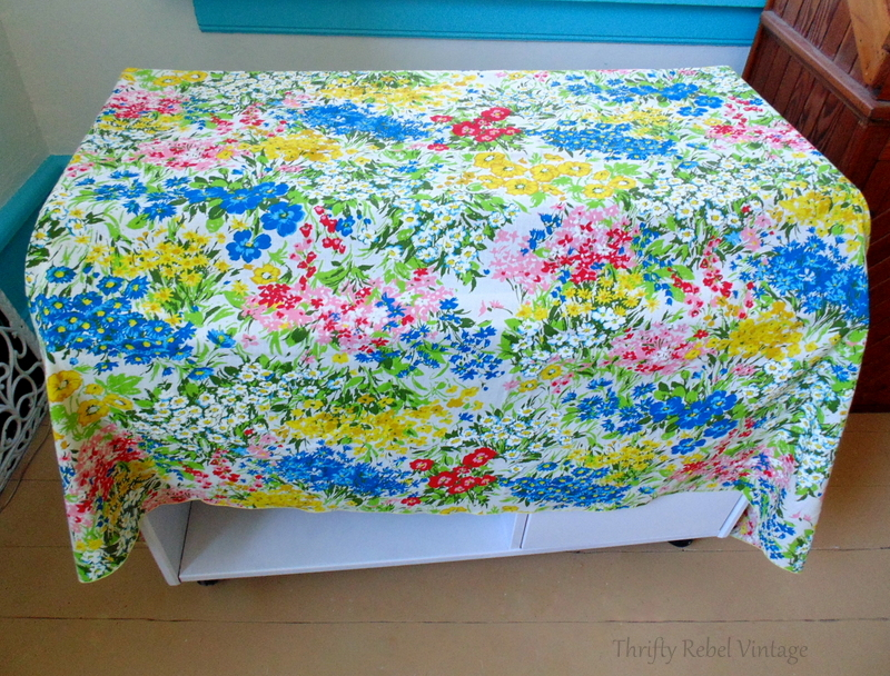 repurposed floral tablecloth used for decopaged desk makeover