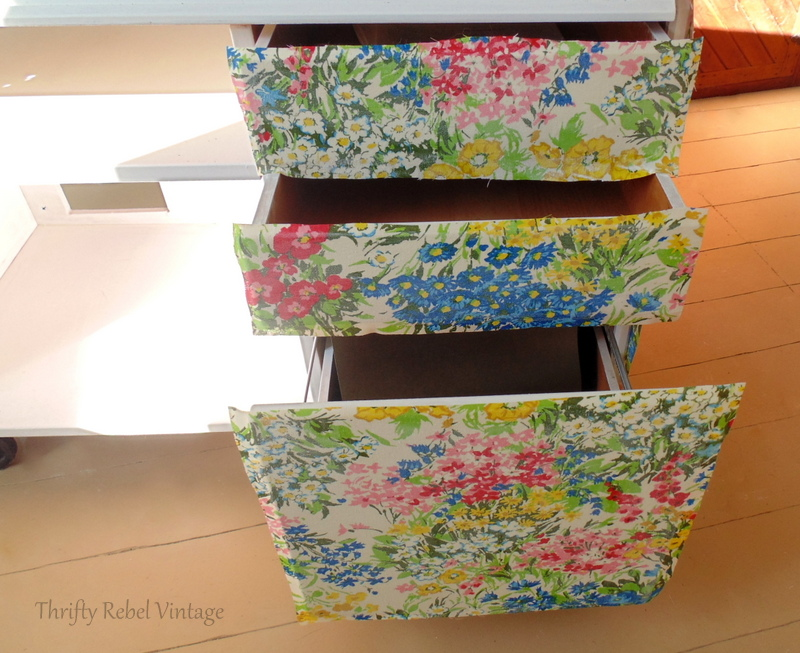 floral fabric decoupaged on to desk drawers
