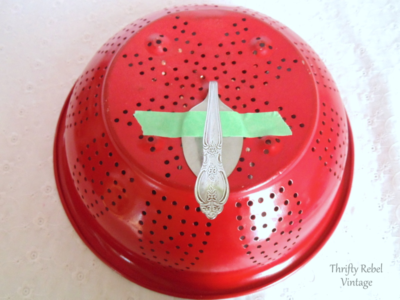 gluing bent tablespoon onto back of red painted strainer
