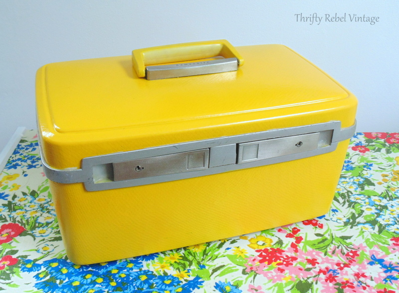 vintage train case makeover by spray painting front view after 1