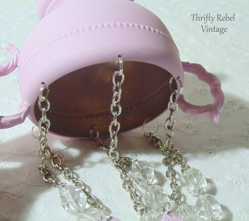 attaching necklace parts to sugar bowl with split rings