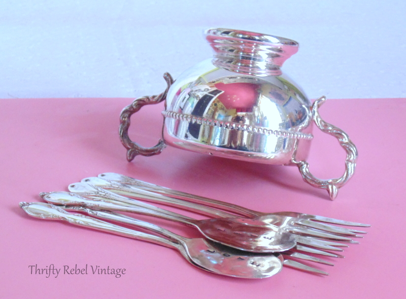 silver polished sugar bowl and spoons and forks
