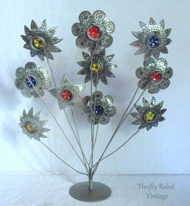 back of vintage light reflector flowers