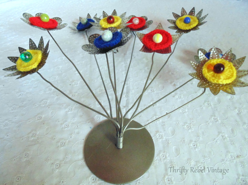 bending back the card holders and repurposed tin light reflector flowers