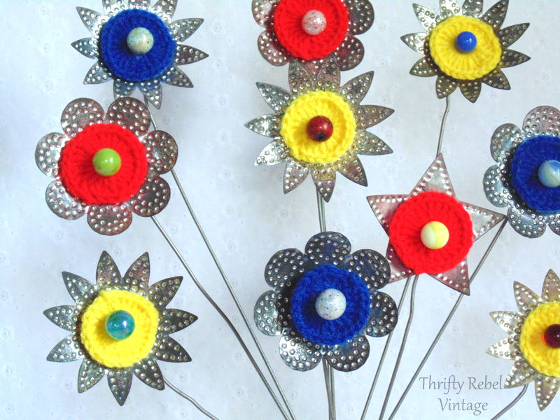 tin light reflector flowers with marbles glued in the centers