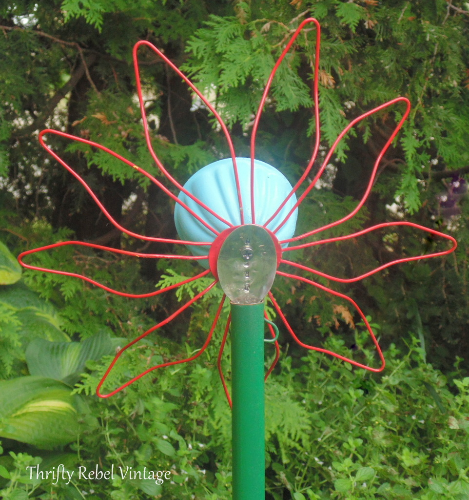 back view of repurposed gutter leaf strainer flowers