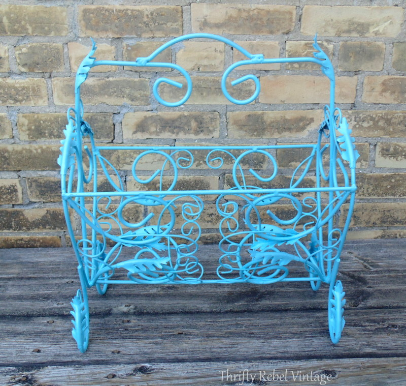 spray painted aqua blue magazine rack planter